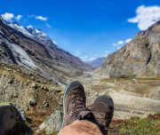stock-photo-hiker-man-hiking-trekking-in-the-himalayan-mountain-pass-relaxing-after-completing-the-trek-418179910